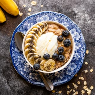 banana bread oatmeal in a white bowl on a blue and white plate