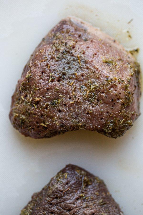 tenderized deer meat on a cutting board
