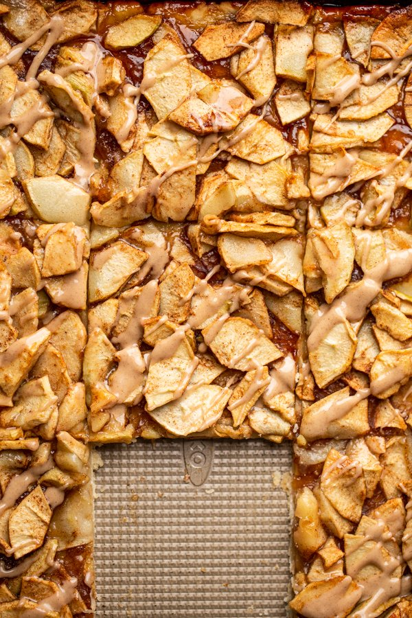 apple pie cut into squares in a baking sheet