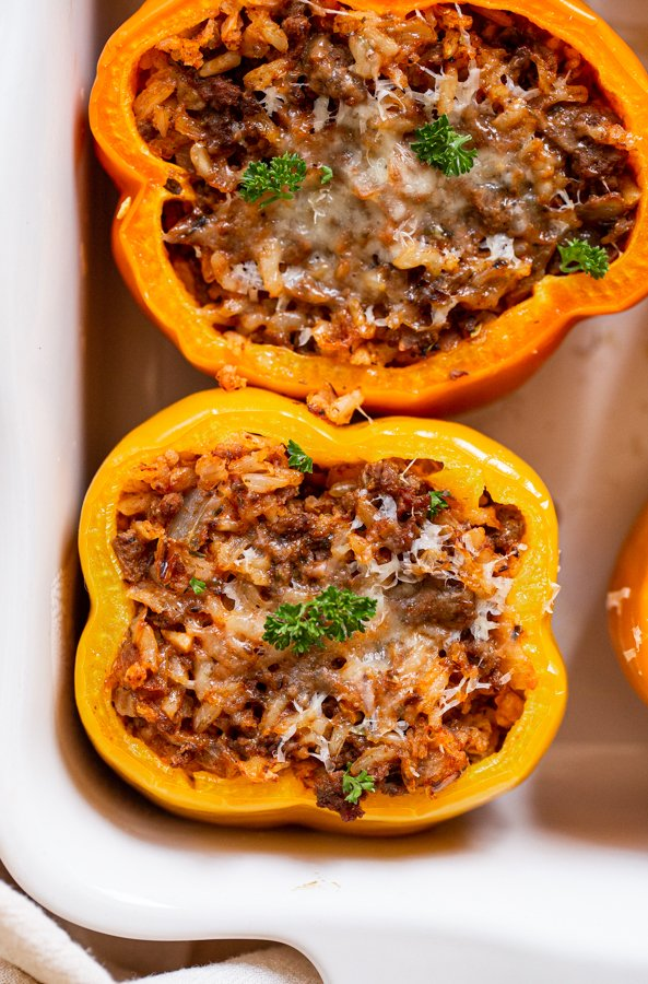 venison stuffed peppers in a white baking dish