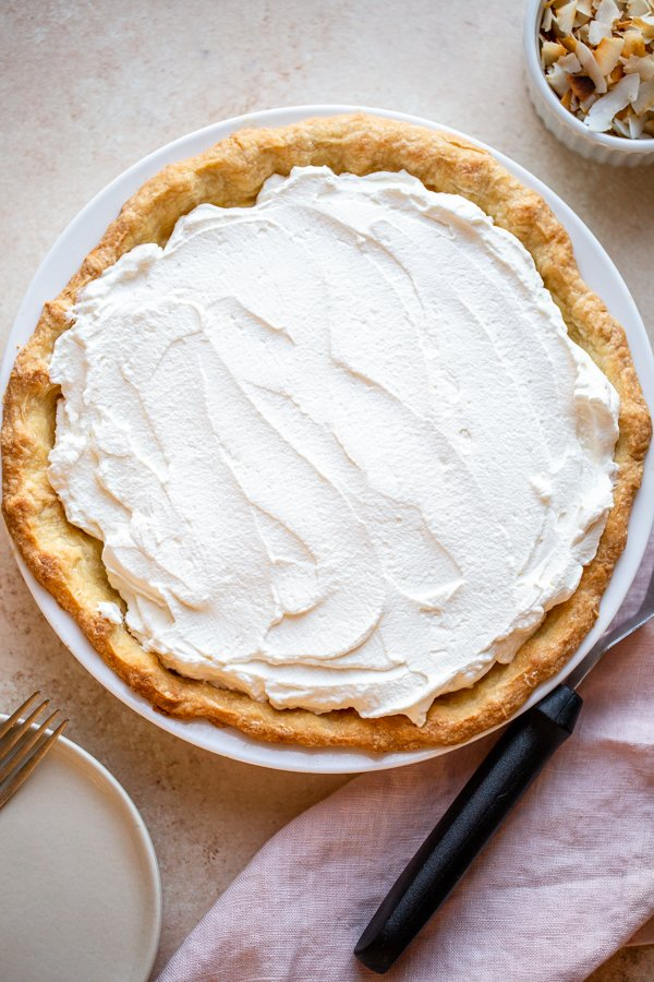 coconut cream pie on a beige counter