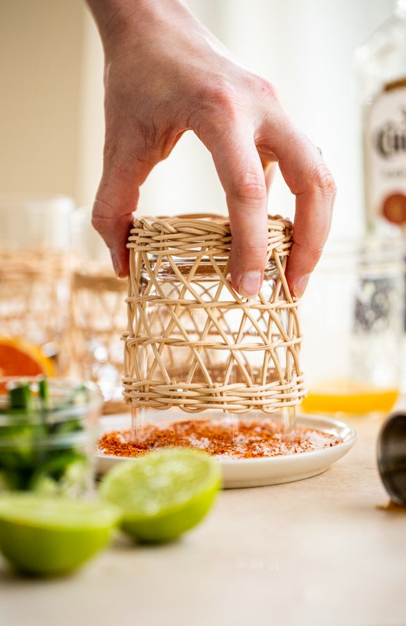 dipping a glass in salt and spices to rim the glass