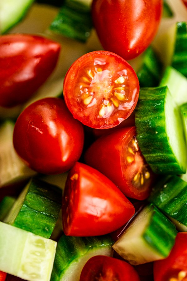 a photo of chopped tomatoes and cucumbers up close